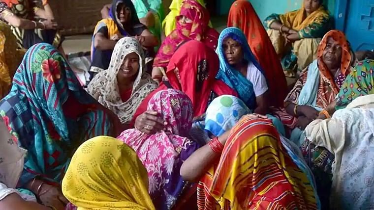 Relatives of the rape victim mourning in Hathras on September 29, 2020.