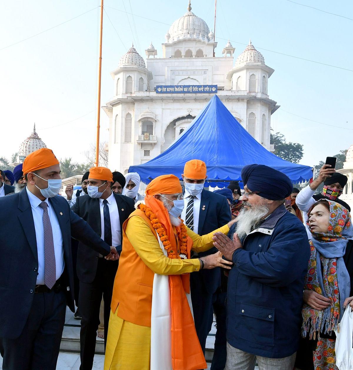 Prime Minister Narendra Modi meets people as he visits Gurudwara Rakab Ganj Sahib on the occasion of the 400th Prakash Parv of Guru Teg Bahadur, in New Delhi on Sunday