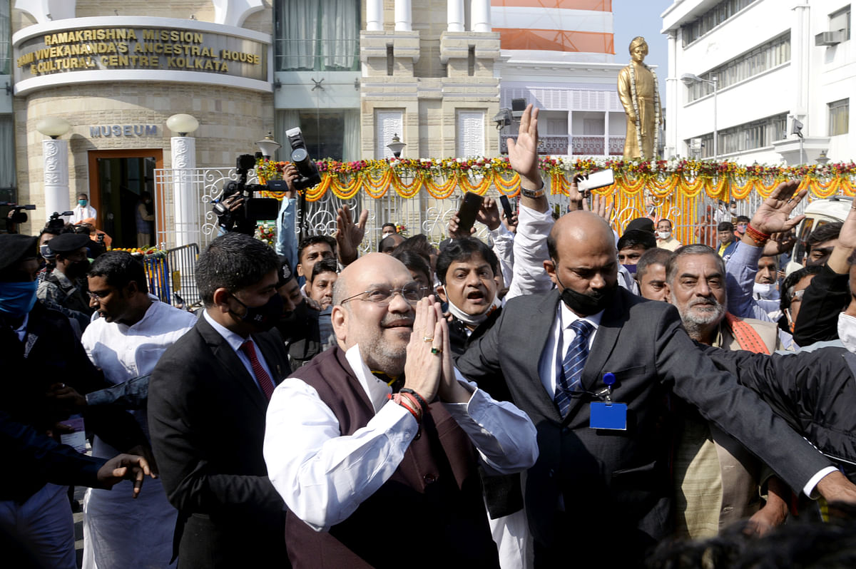 Union Home Minister Amit Shah waves to supporters during his visit to Swami Vivekanand ancestral house, in Kolkata on Saturday.
