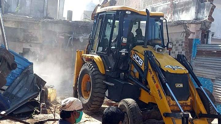 BMC team demolishes house of gangster Raees Radio in Khanugaon on Monday.