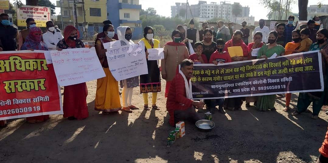 Social activists protest over bad road conditions at Baghmugalia, Bhopal, on Sunday.