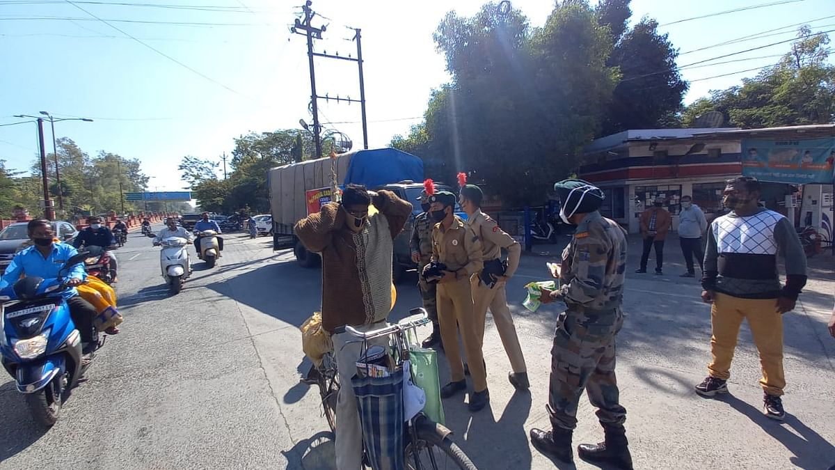 10 MP Battalion NCC cadets and staff members distribute hand wash bottles and masks to passersby under their Covid-19 awareness drive