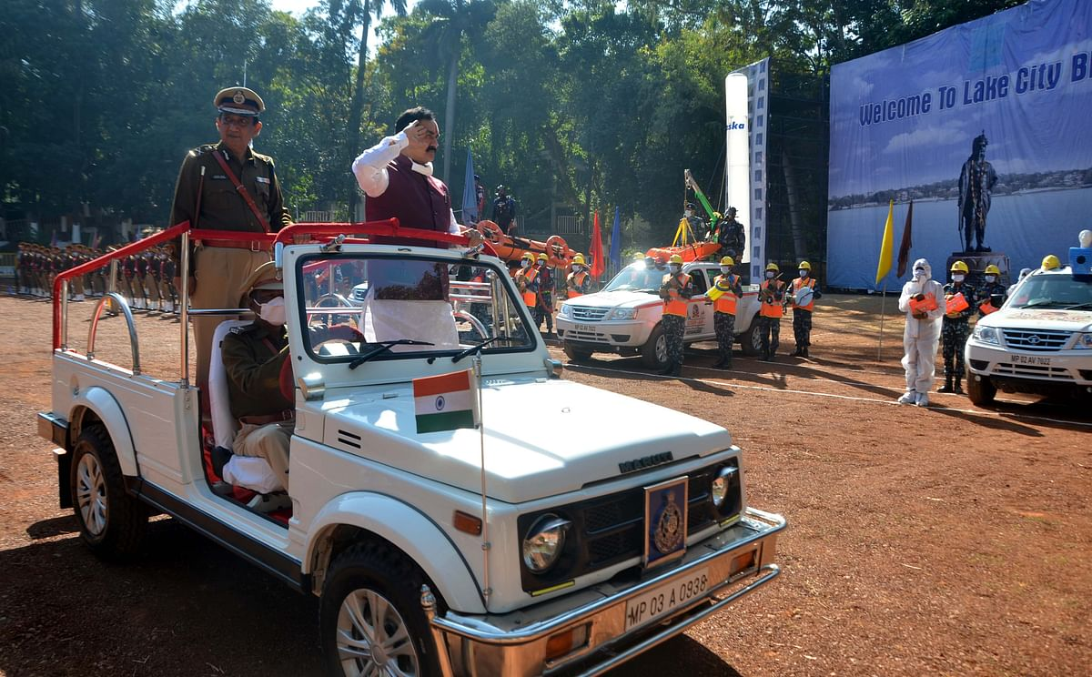 MP Home minister Dr Narottam Mishra takes the salute at a parade in Bhopal