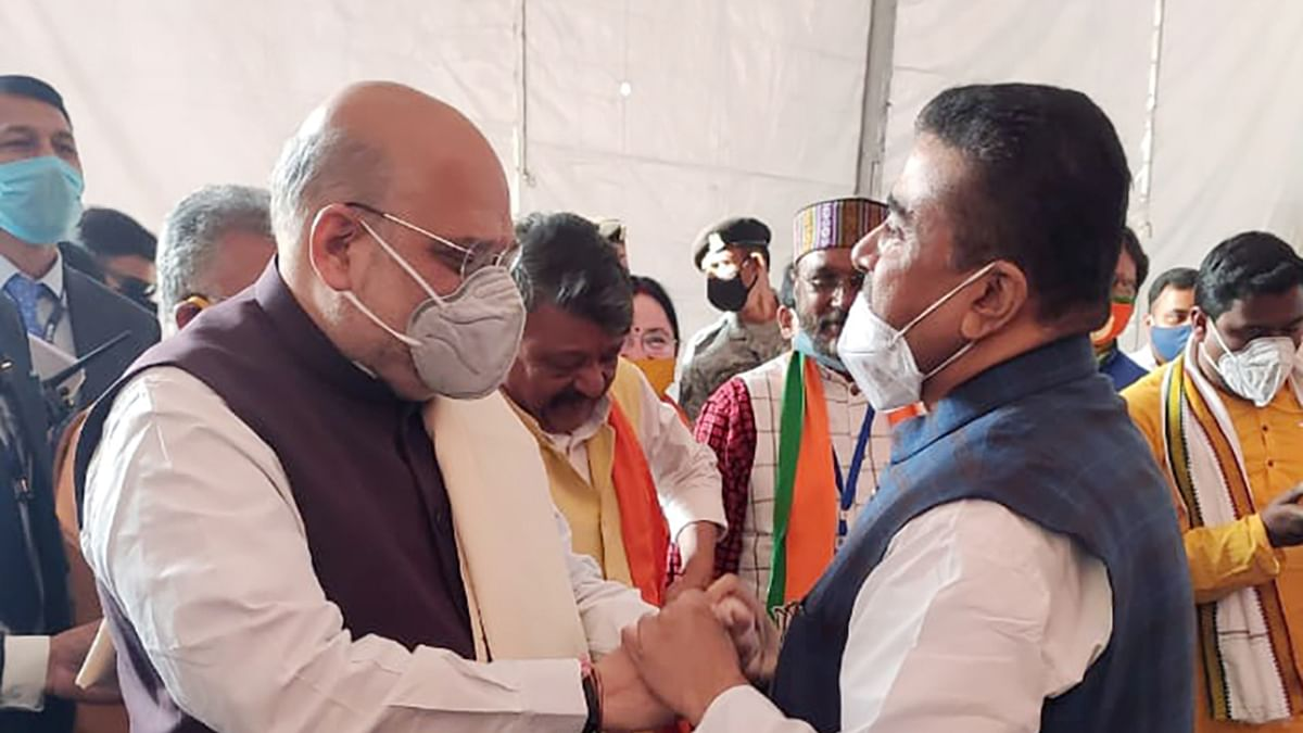 Home Minister Amit Shah interacts with Suvendu Adhikari during a public rally, at Midnapore College Ground, in Midnapore on Saturday.