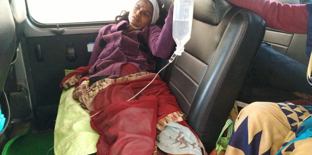 Injured Heemabai taken to the district hospital after she was attacked by her husband