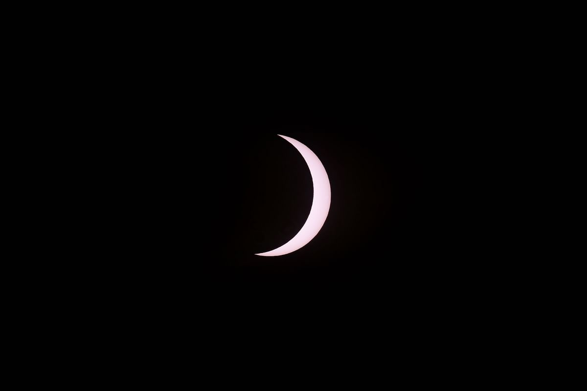 A sliver of the sun is seen just before totality during the total solar eclipse as seen from Piedra del Aquila, Neuquen province, Argentina on December 14, 2020.