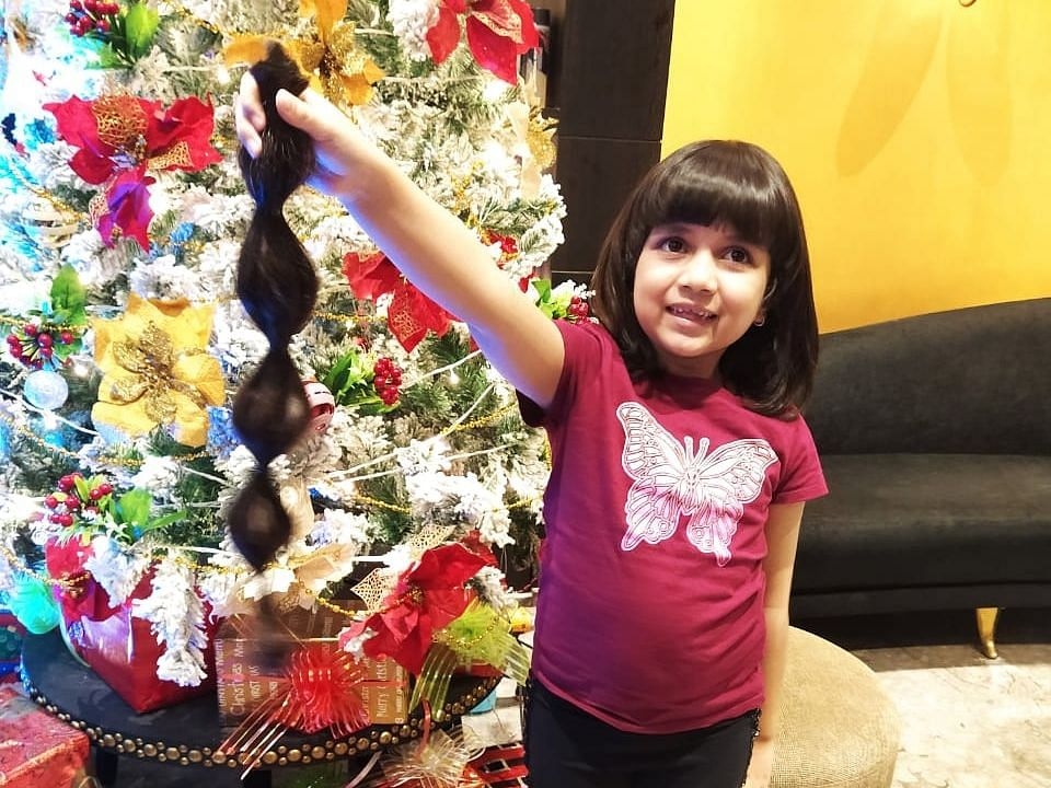 Six-year-old cuts her 'Rapunzel' hair to make a wig as a Christmas gift for cancer patients