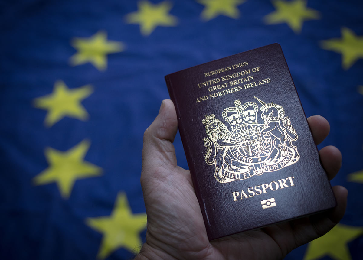 European product for non-EU Britain? UK unveils 'iconic' blue post-Brexit passports made by French-Dutch company in Poland