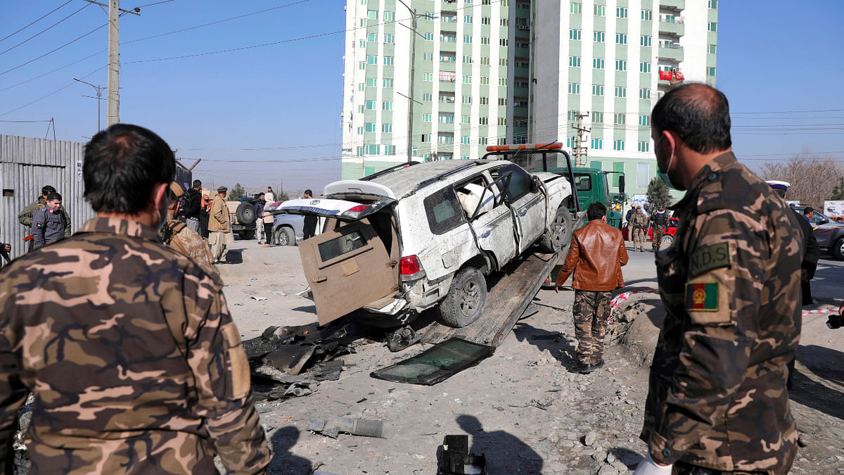 Afghan security personnel inspect the site of a bomb attack in Kabul, Afghanistan, Tuesday, Dec. 15, 2020.