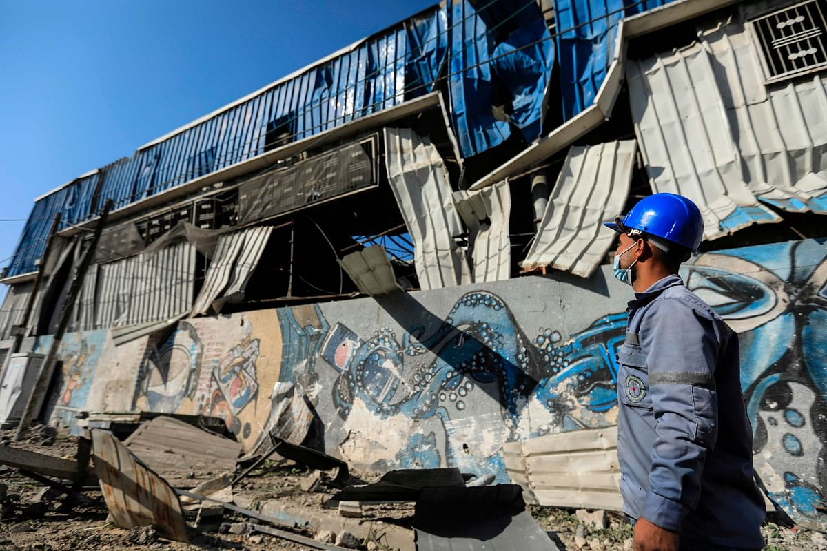 A Palestinian man checks damage caused by an Israeli air strike on Gaza City, on December 26, 2020. - Israel targeted a number of sites in Gaza after Palestinian militants fired rockets into the south of the country, the army said today. (Photo: AFP)