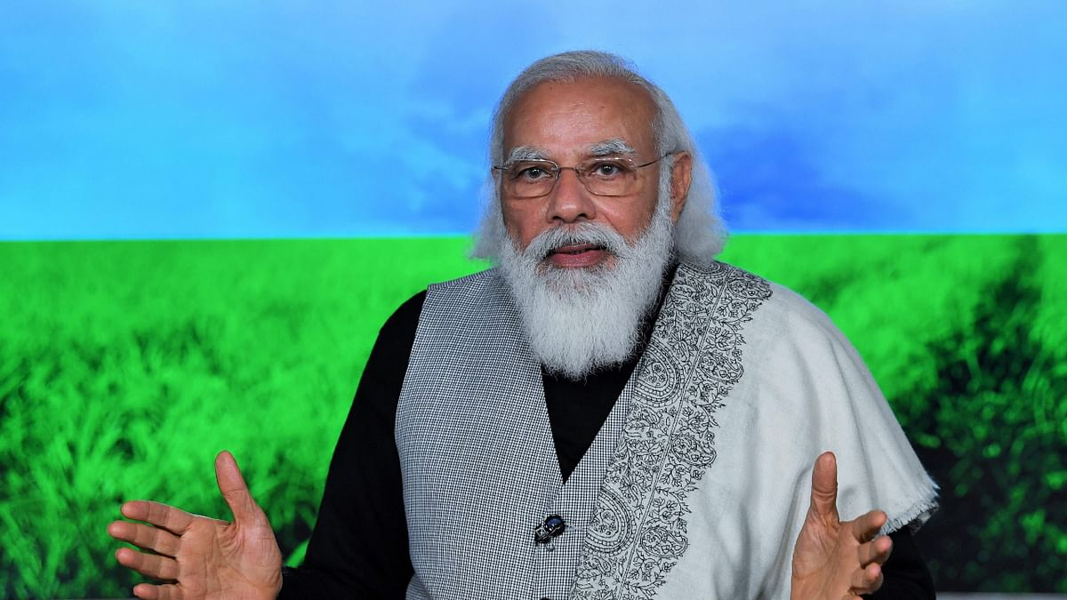 Prime Minister Narendra Modi releasing the next instalment of financial benefit under PM Kisan Samman Nidhi through video conference in New Delhi.
