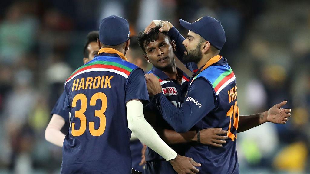 T Natarajan celebrates with Virat Kohli and Hardik Pandya