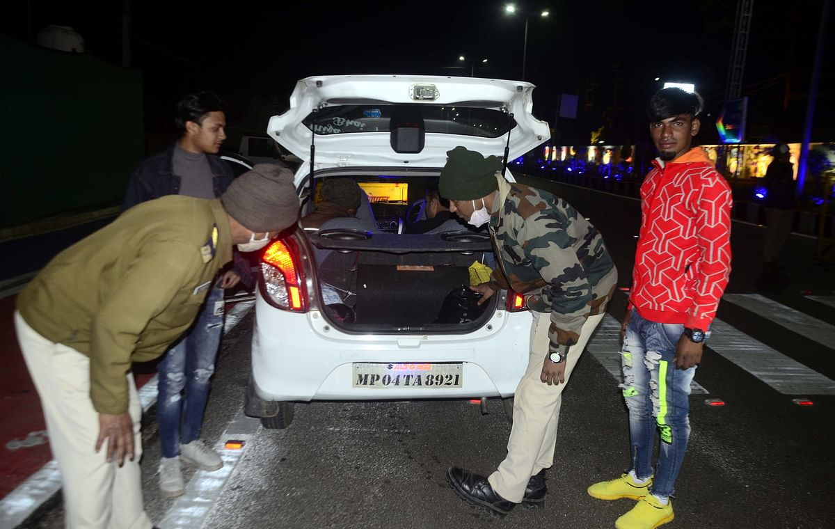 Bhopal police check the roads in the city ahead of the New Year eve on Wednesday.