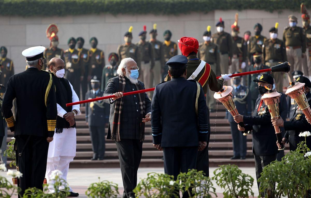 "Prime Minister Narendra Modi lights the ""Swarnim Vijay Mashaal"" at the National War Memorial"
