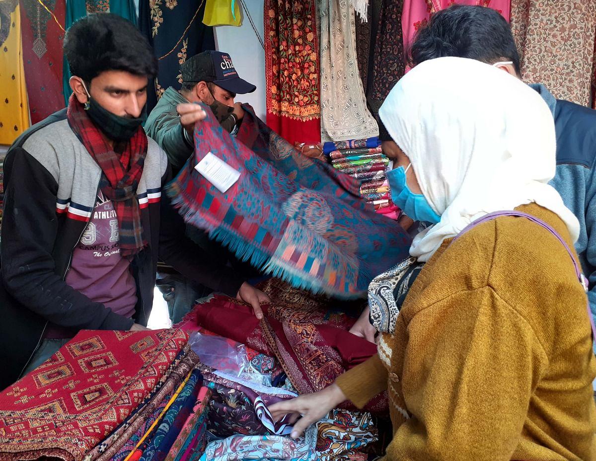 Artisans showing  Pashmina Shawls on J&K  stall at Gauhar Mahal.