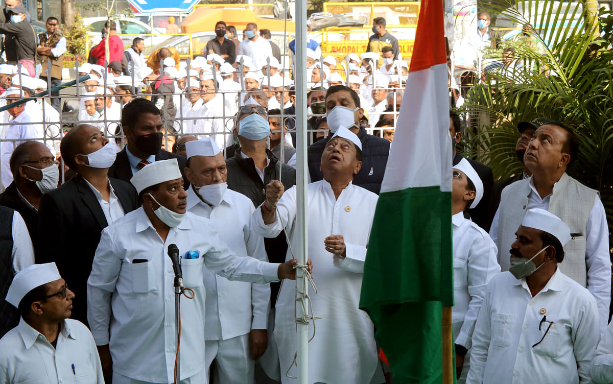 Madhya Pradesh State Congress President Kamal Nath hoists the Congress flag during the 136th foundation day of the Congress party at PCC headquarters in Bhopal.