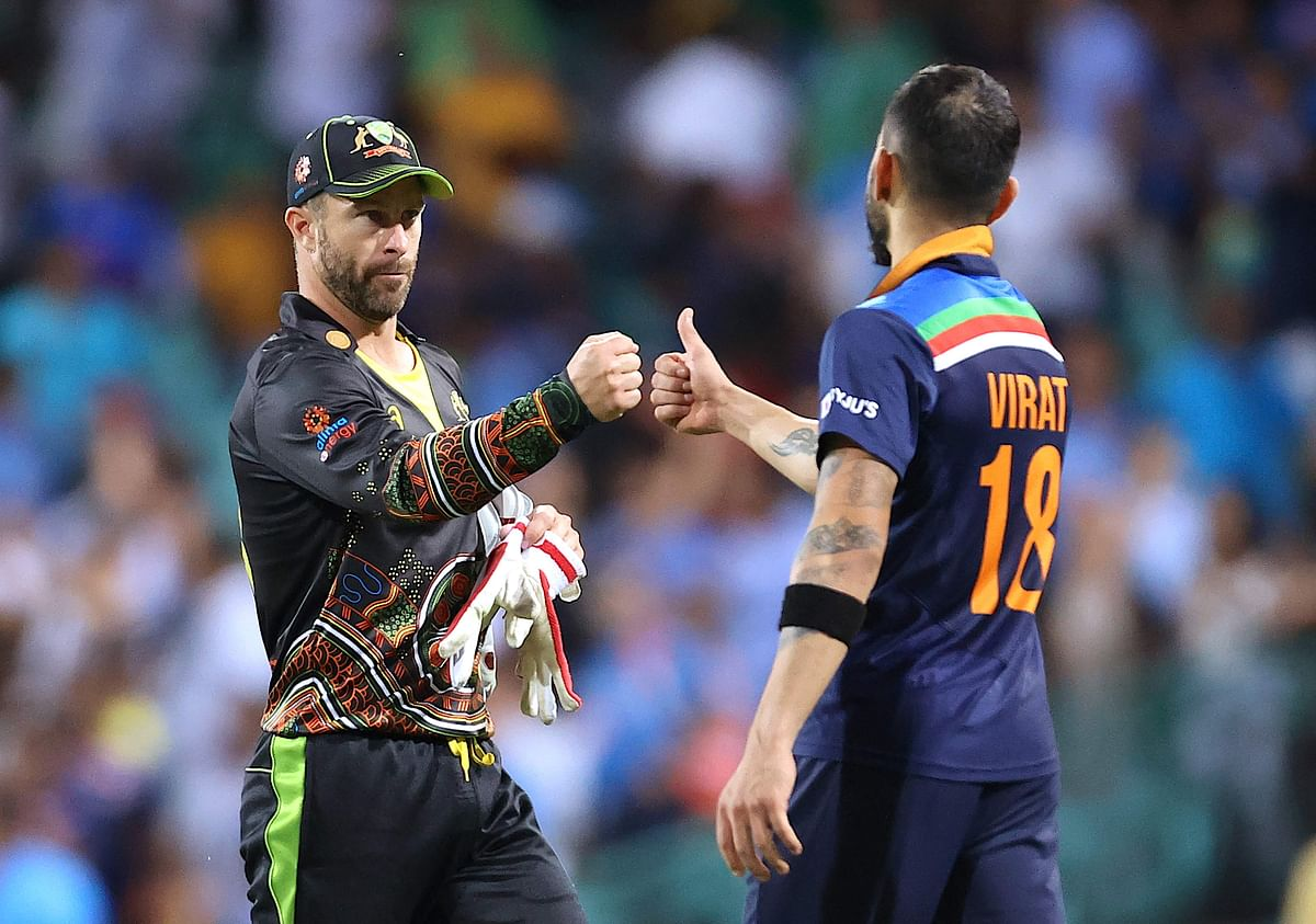 Australia's captain Matthew Wade (L) greets his Indian counterpart Virat Kohli for victory in the second T20 cricket match between India and Australia at the Sydney Cricket Ground in Sydney on December 6, 2020.
