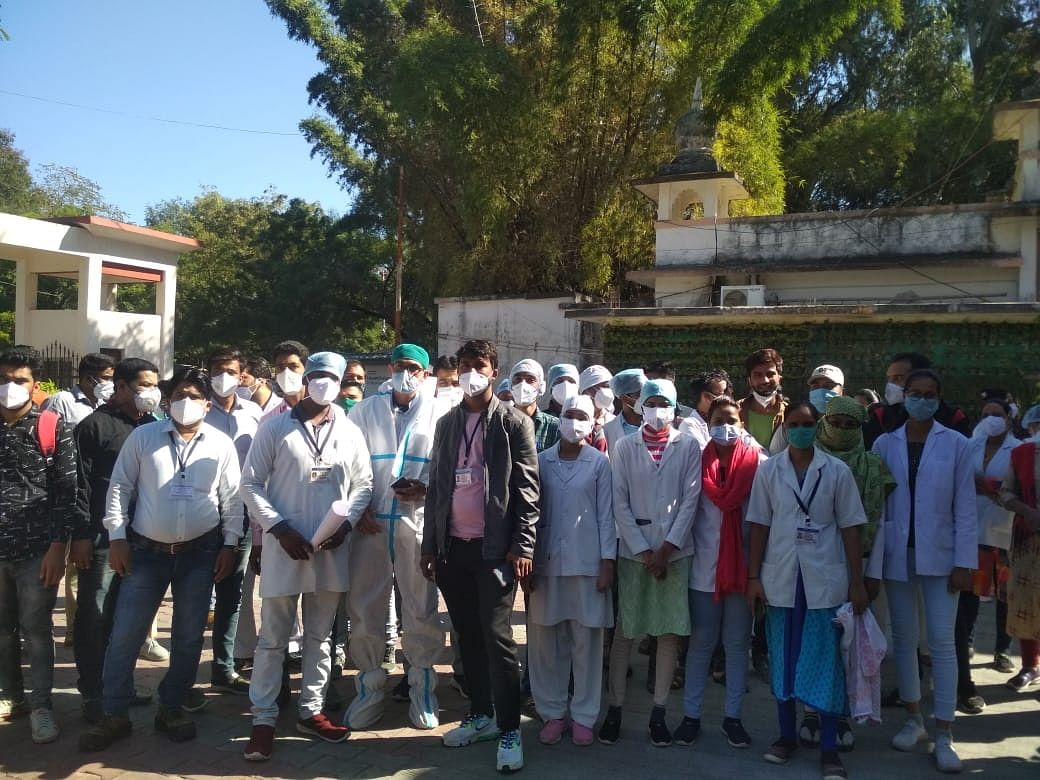 Temporary healthcare workers staging a demonstration, in Ujjain on Friday