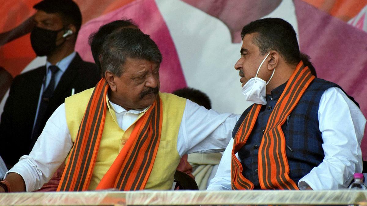 BJP General Secretary Kailash Vijayvargiya and BJP leader Suvendu Adhikari during a public rally, in Paschim Medinipur on Saturday.
