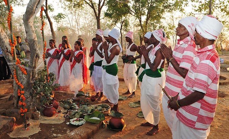 Tribals performing worship at Sarna