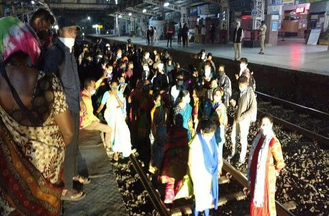 Western Railway passengers sit on tracks over Dahanu train timing