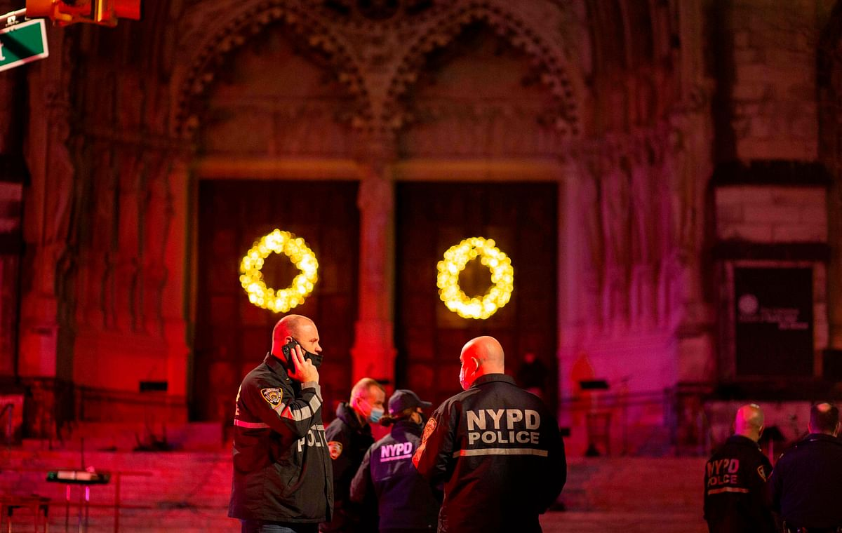 Police patrol outside of the Cathedral of St. John the Divine in New York on December 13, 2020, after a shooter opened fire outside the church