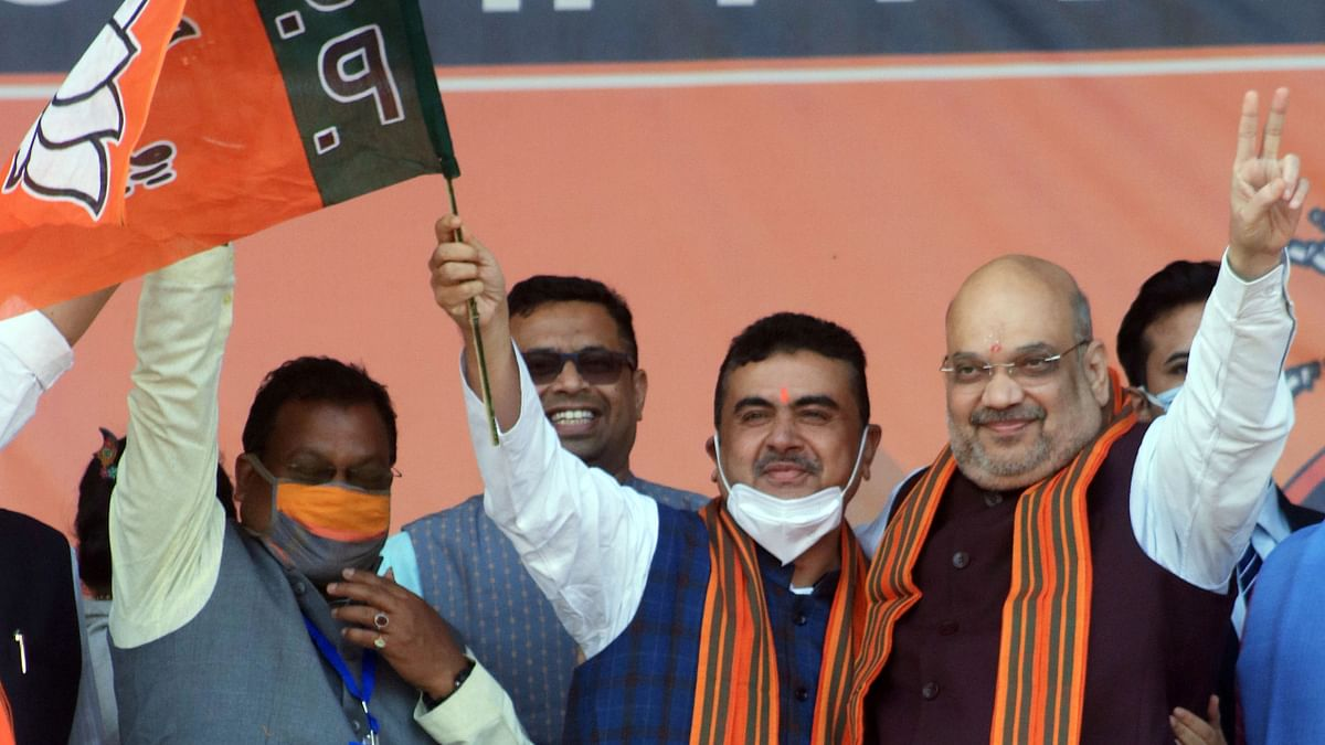 BJP leader Suvendu Adhikari with Union Home Minister Amit Shah during a public rally