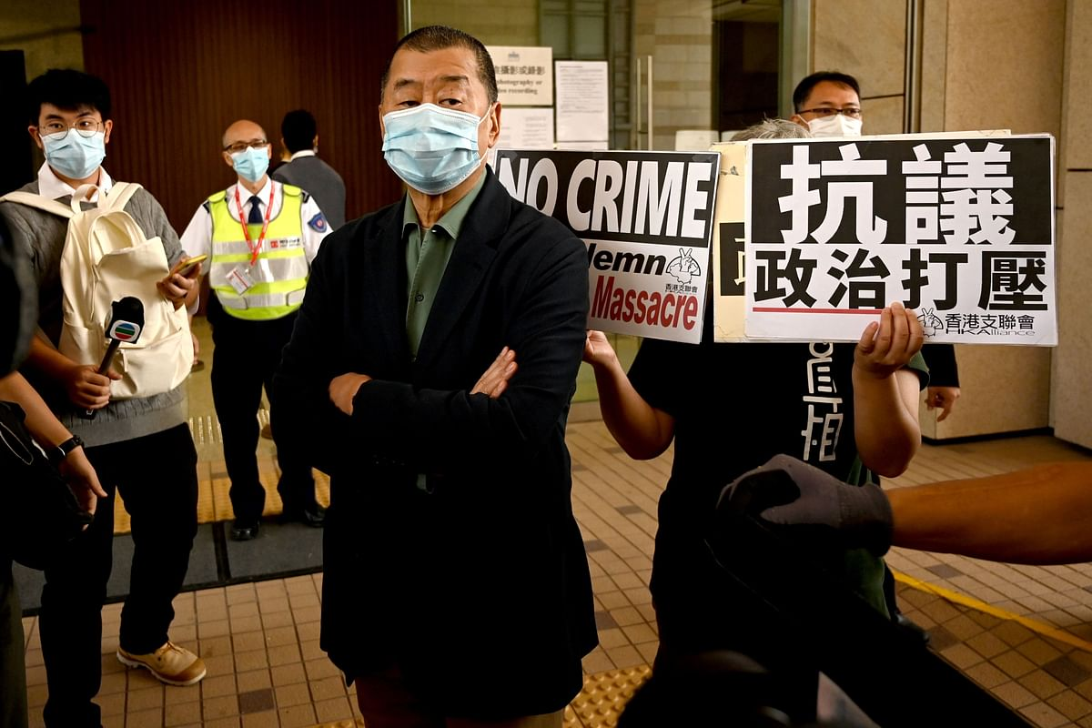 Hong Kong media tycoon charged under controversial new law