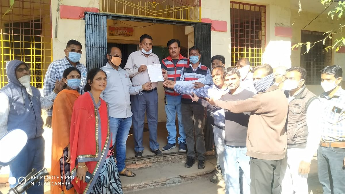 Government teachers from Bagh village of Dhar district submitting memorandum to the block education officer in Bagh of Dhar district
