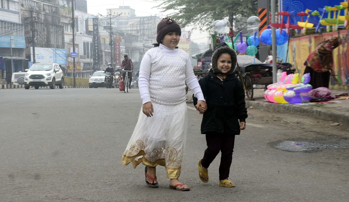 Children in woollens take all precautions against the chill in the state capital, Bhopal, on Wednesday.