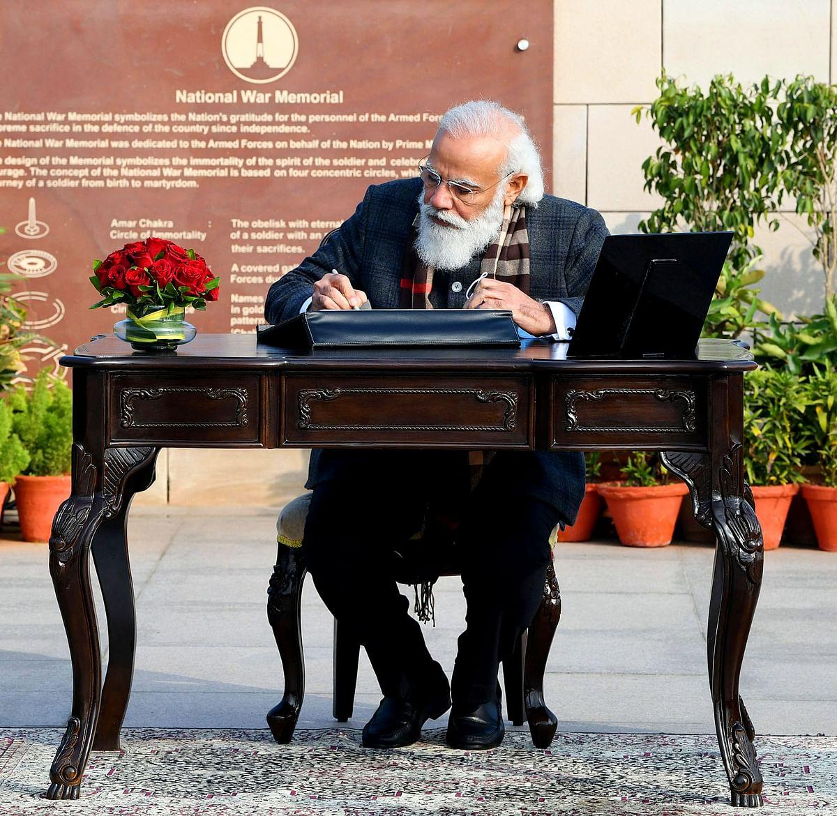Prime Minister Narendra Modi signing the visitors book at the National War Memorial