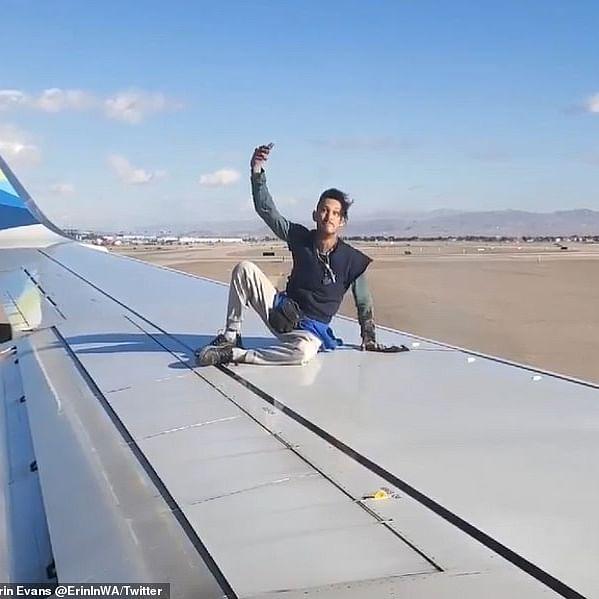 Man on wing: A strange sight for Las Vegas flight passengers