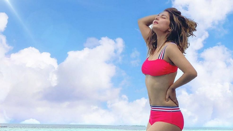 Here's Hina Khan looking like a million bucks in a hot red bikini on her Maldives vacay
