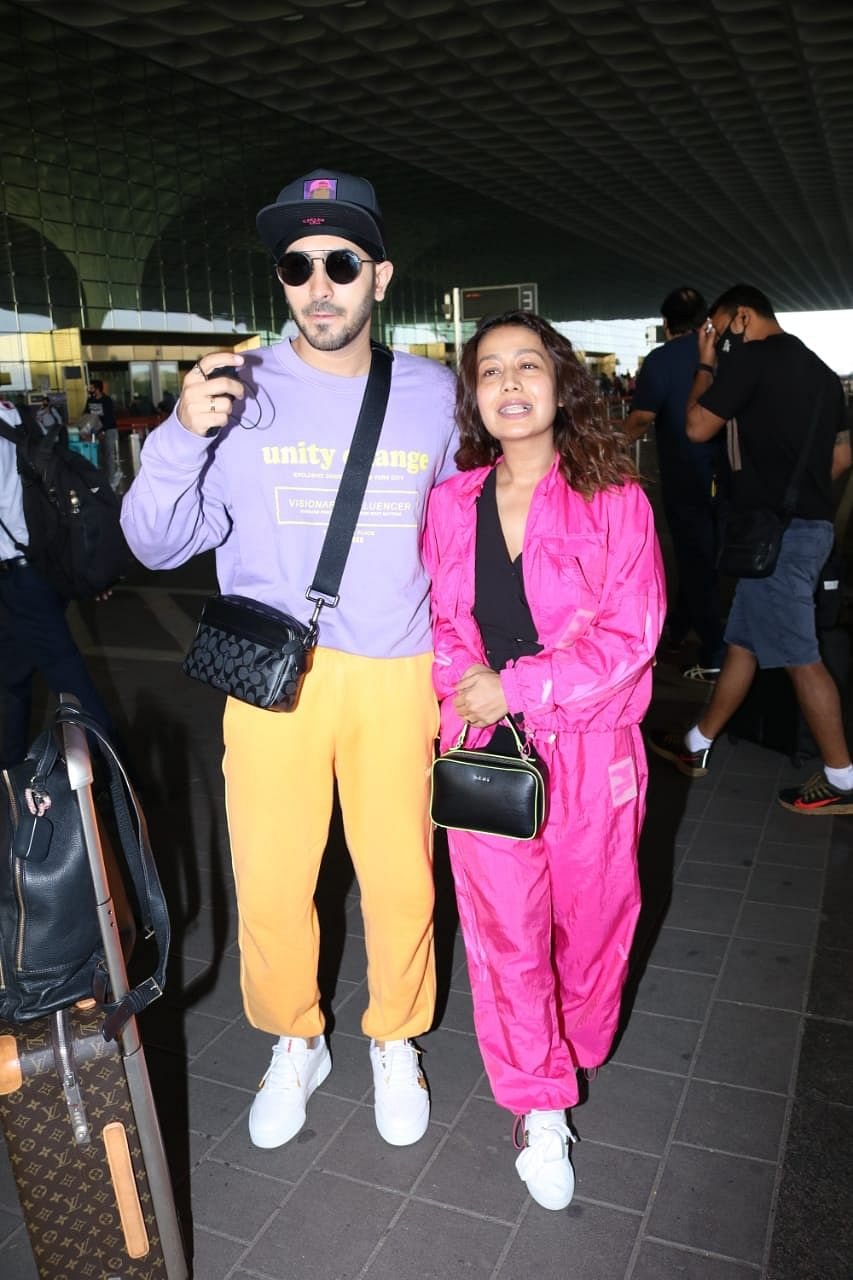In Pics: Amid pregnancy rumours, Neha Kakkar spotted without a 'baby bump' at Mumbai airport