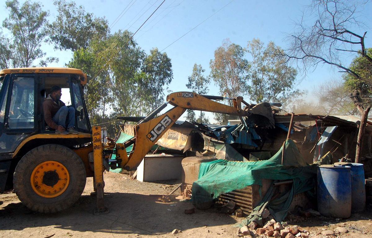 Encroachments being removed from 11 Mill Square under Misrod police station on Saturday.