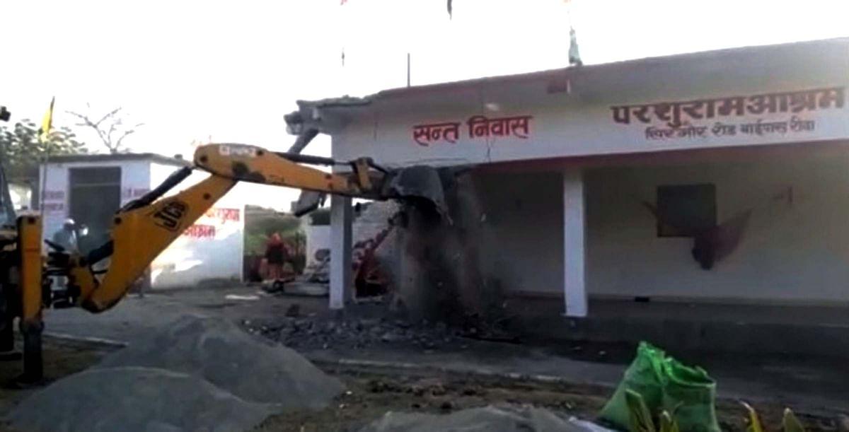 A portion of Parshuram Ashram being demolished in Rewa.