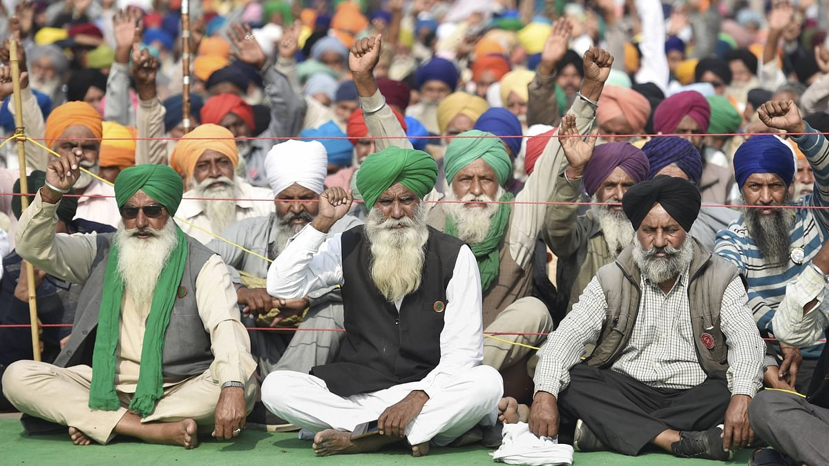 Farmers stage a protest at Singhu border during their Delhi Chalo march against the Centres new farm laws