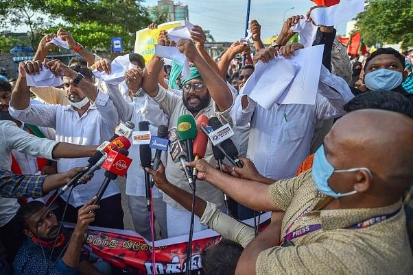 SDPI workers recently tore copies of the new farm bills in protest