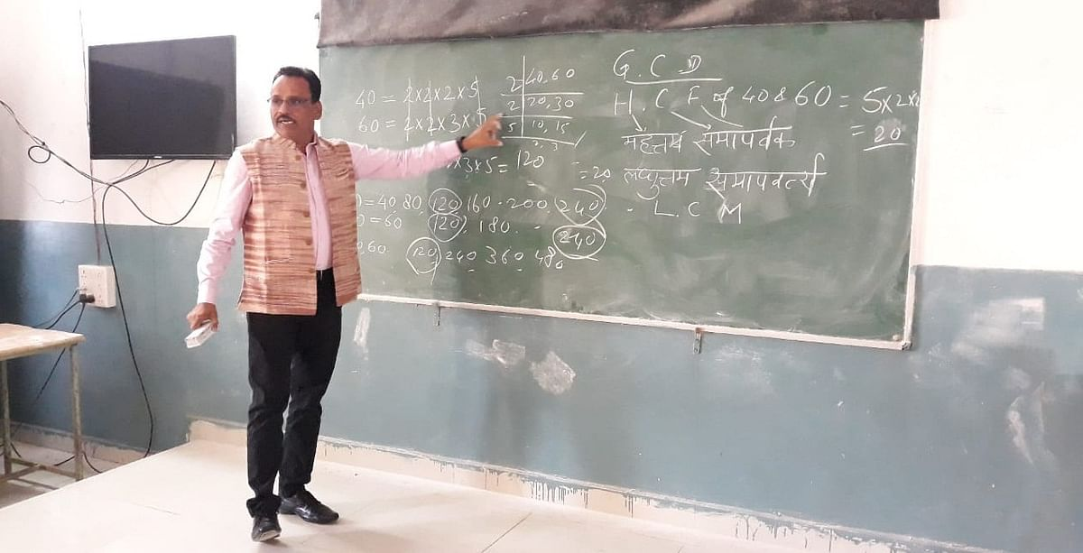 Barwani district collector Shivraj Singh Verma teaches mathematics at school of excellence