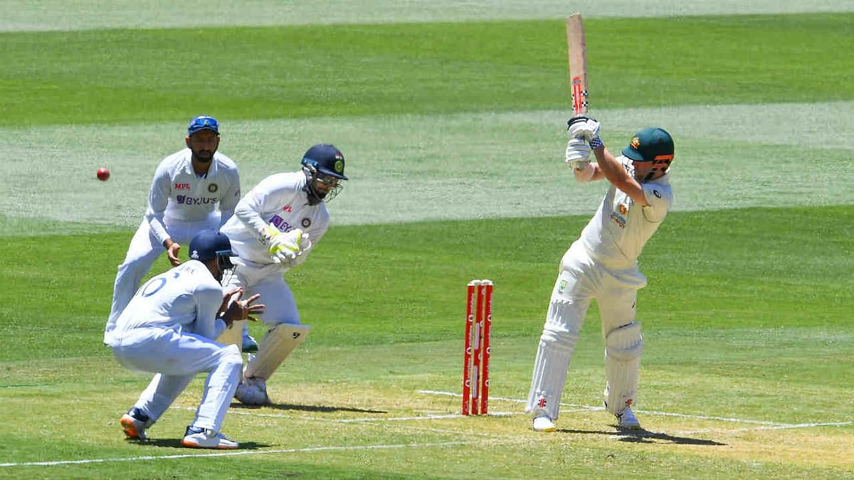 Australia's Travis Head (R) plays a ball to leg on the first day of the second cricket Test match between Australia and India played at the MCG in Melbourne on December 26, 2020