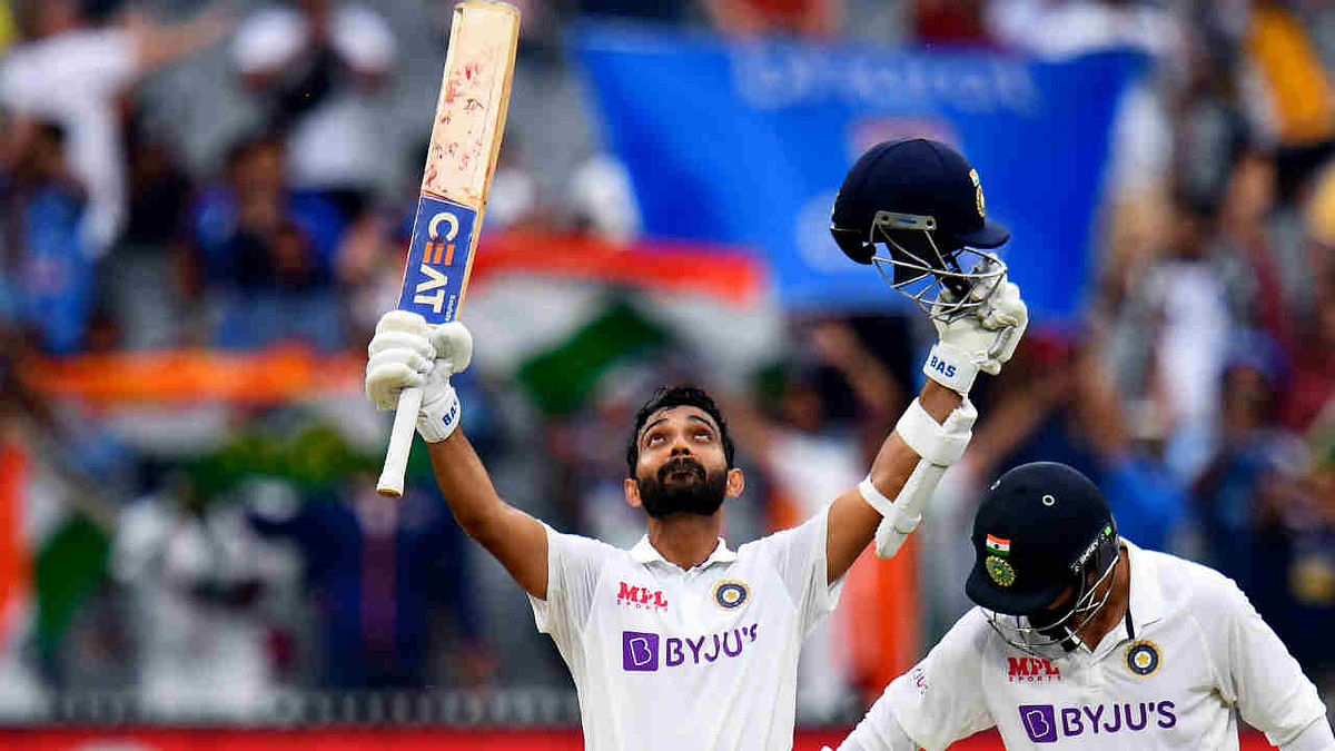 Ajinkya Rahane (L) celebrates scoring his century (100 runs) as teammate Ravi Jadeja (R) looks on during the second day of the second cricket Test match between Australia and India at the MCG in Melbourne on December 27, 2020