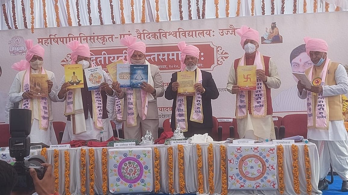 Guests releasing books on astrological calculations during the second convocation ceremony of Maharishi Panini Sanskrit evam Vedic Vishwavidyalaya