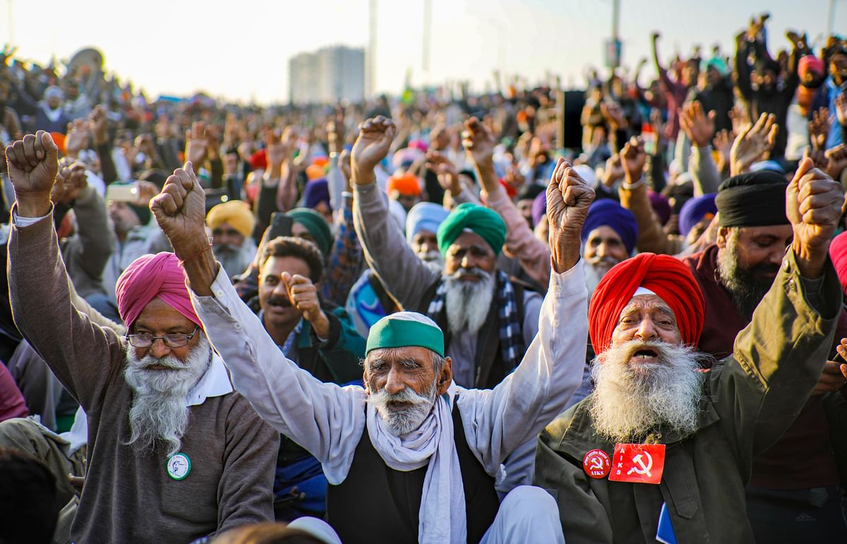 Farmers shout slogans during their protest against the new farm laws, at Ghazipur border in New Delhi, Tuesday, Dec. 29, 2020.
