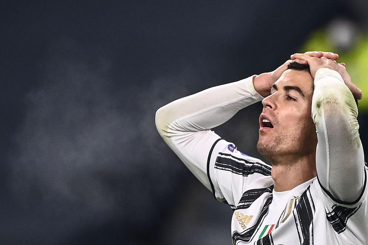 Juventus' Portuguese forward Cristiano Ronaldo reacts during the match