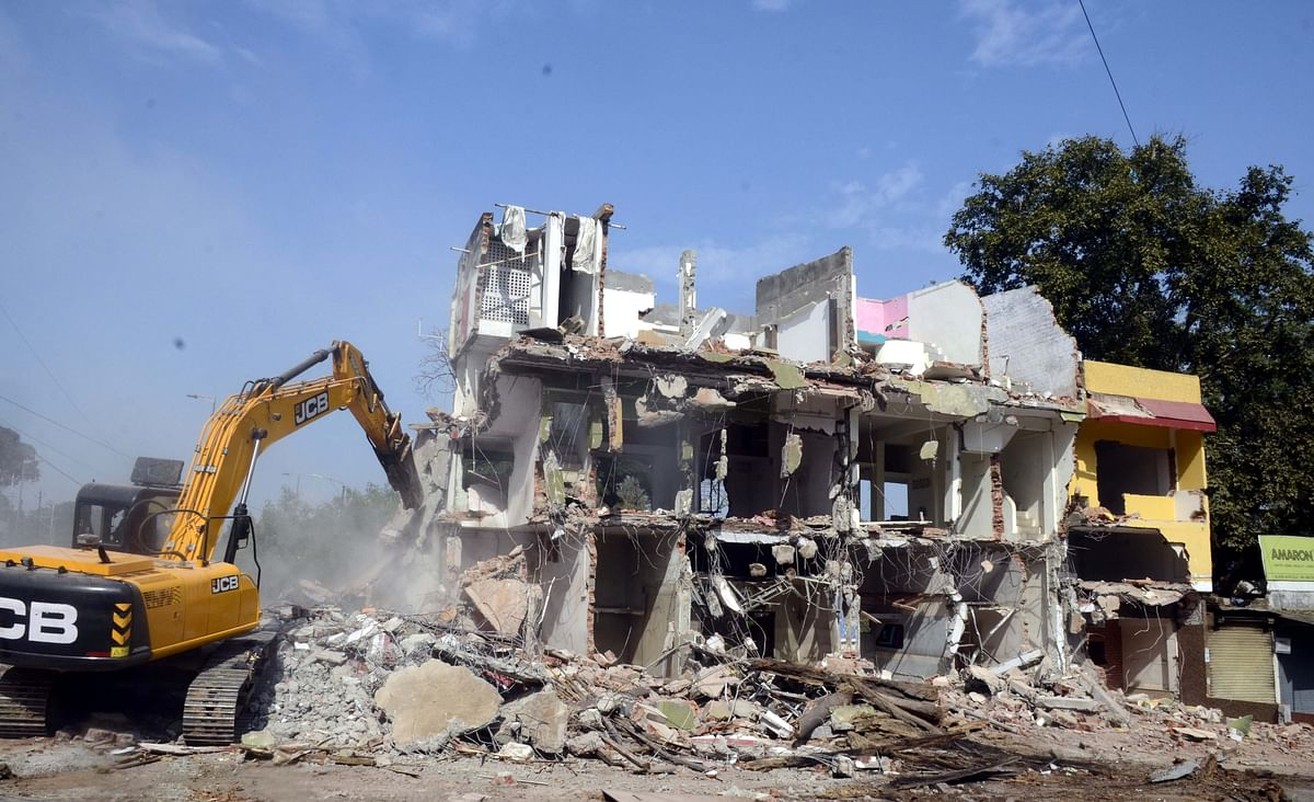 District administration demolishes houses for clearing way for approach road construction to arch-bridge in Bhopal on Thursday.