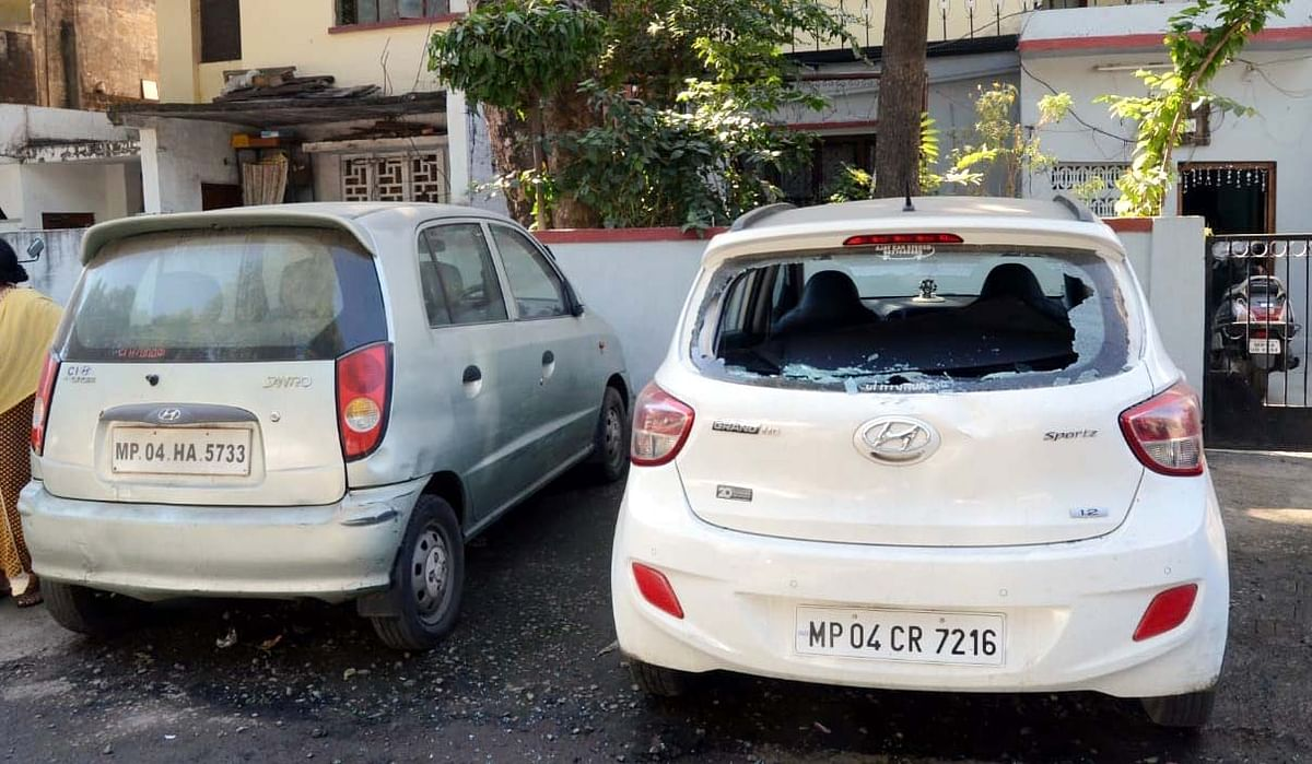 The two cars vandalized by miscreants in Shastri Nagar, Bhopal.