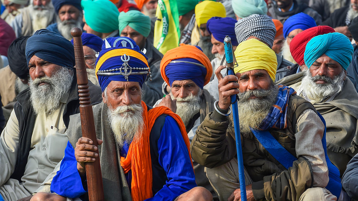 New Delhi: Farmers during their ongoing protest against new farm laws, at Singhu border in New Delhi, Thursday, Dec 31, 2020.