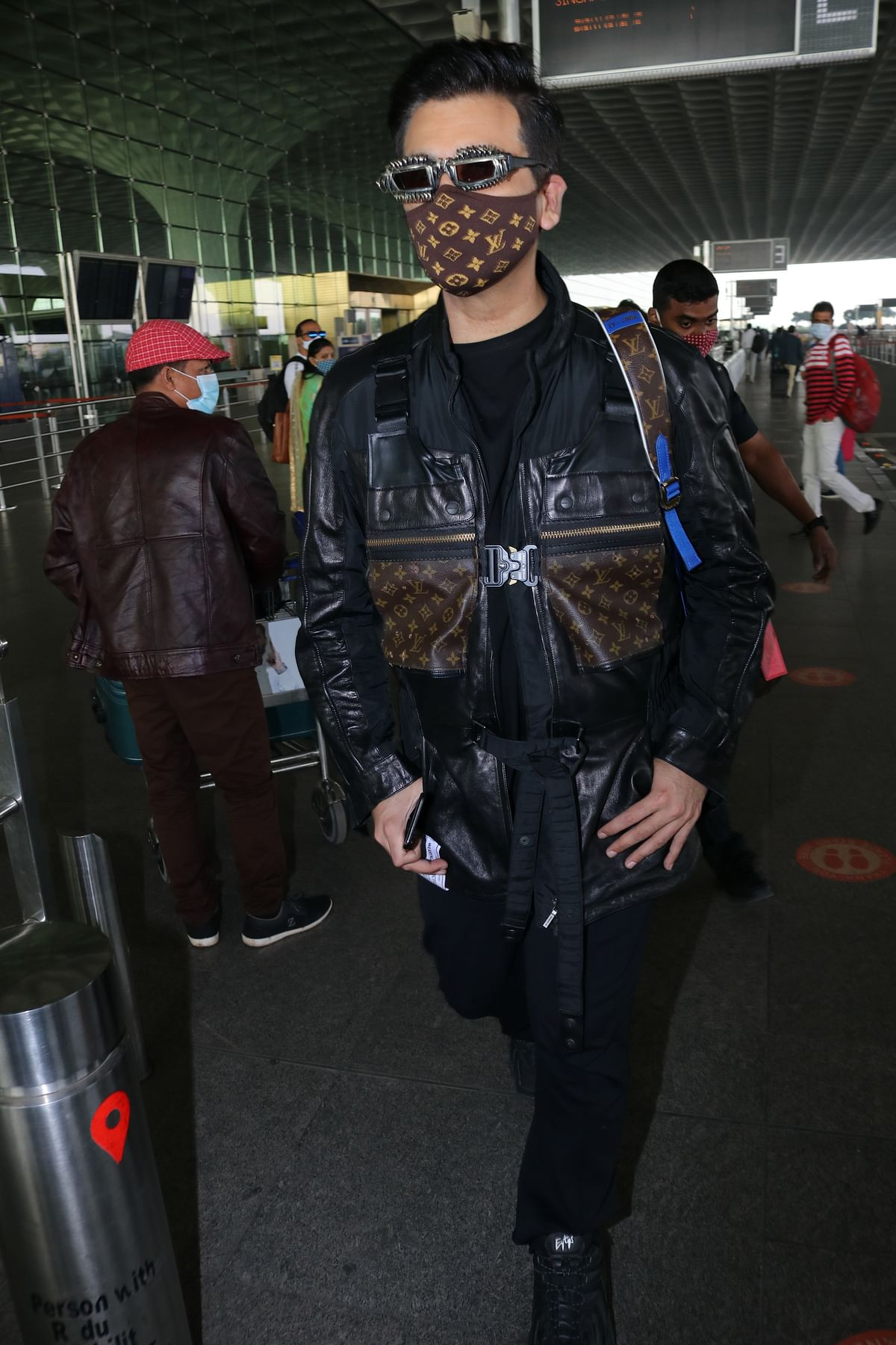 'Monkey, disaster, robot': Karan Johar trolled for his quirky Louis Vuitton airport look