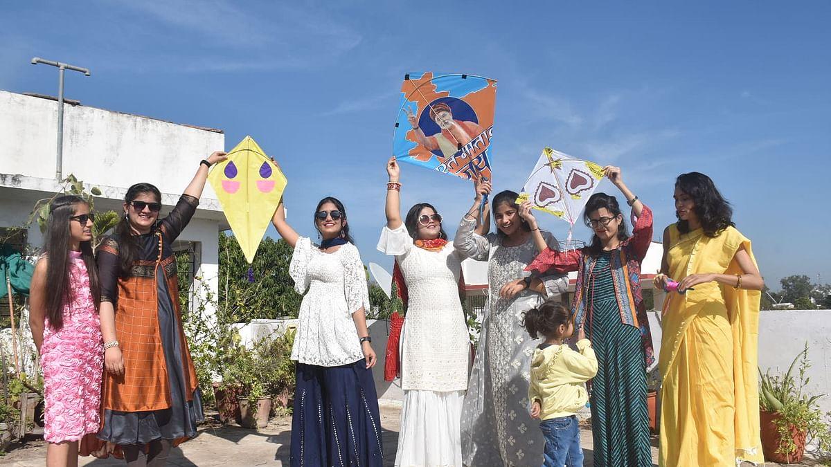 Girls enjoy flying kites