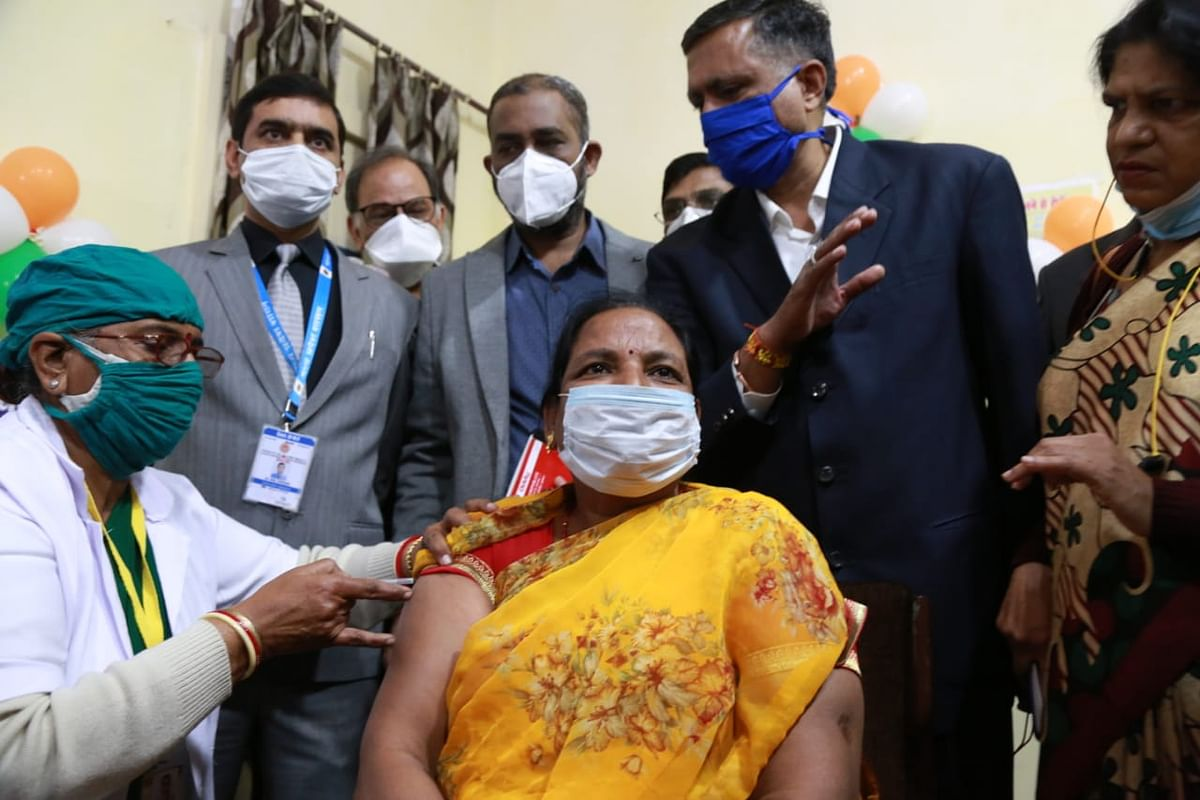 District hospital staffer Asha Pawar receiving vaccine at MY Hospital on Saturday morning